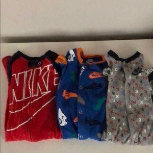 3 NIKE footie pajamas. Size 9 months
